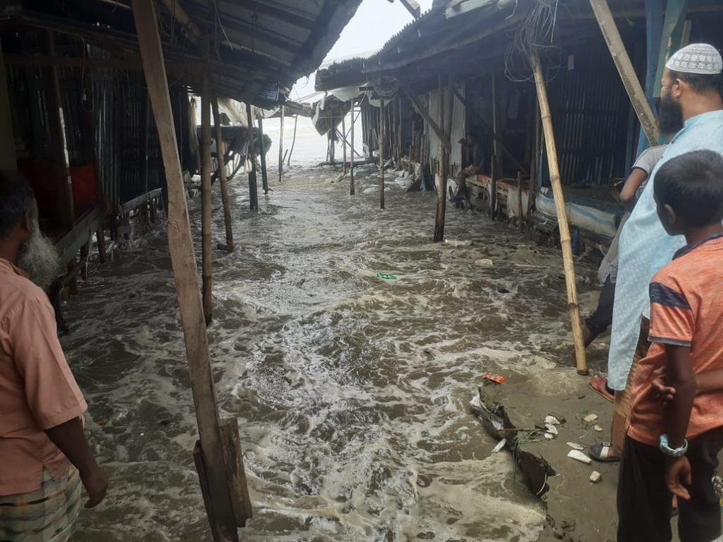 Villagers look on helplessly as brackish water floods their bazaar. © A J GHANI - Cyclone Yaas