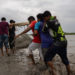 Local villagers desperately try to raise the embankment. Munsiganj, Satkhira - Cyclone Yaas